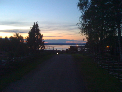The midnight sun over Tällberg, with Lake Siljan in the distance.